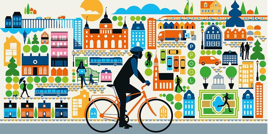 Färglad illustration av en stad med en cyklist i förgrunden